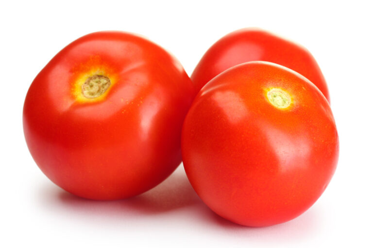 Ripe red tomatoes isolated on white